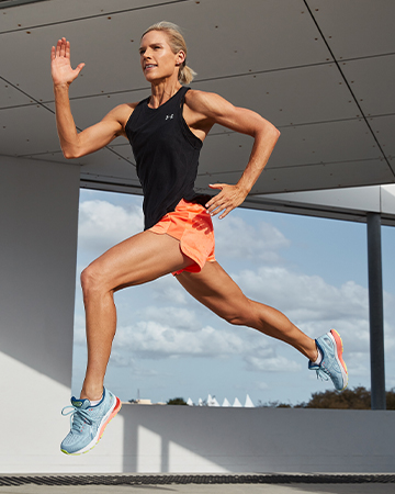 Queenslands mature female fitness jumpng through the air