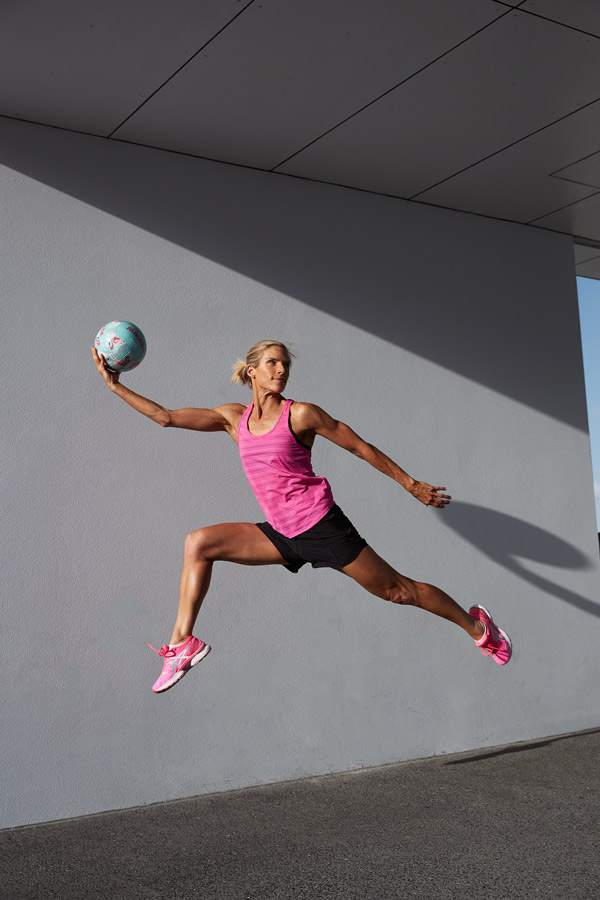 Queenslands mature female fitness model cathing a netball
