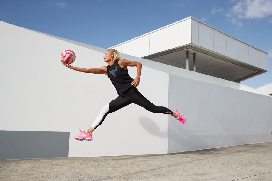 Queenslands mature female fitness model jumping out to catch a netball