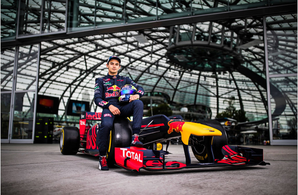 Red Bulls Luis seated on the redbull car