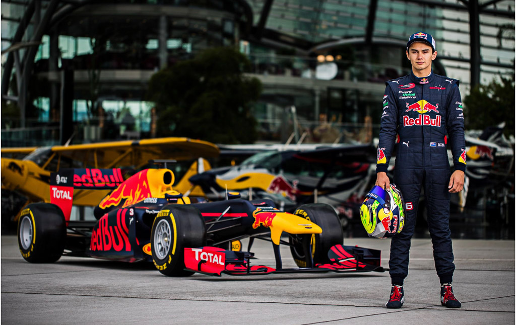 Red Bulls Luis standing in front of the red bull formula one car