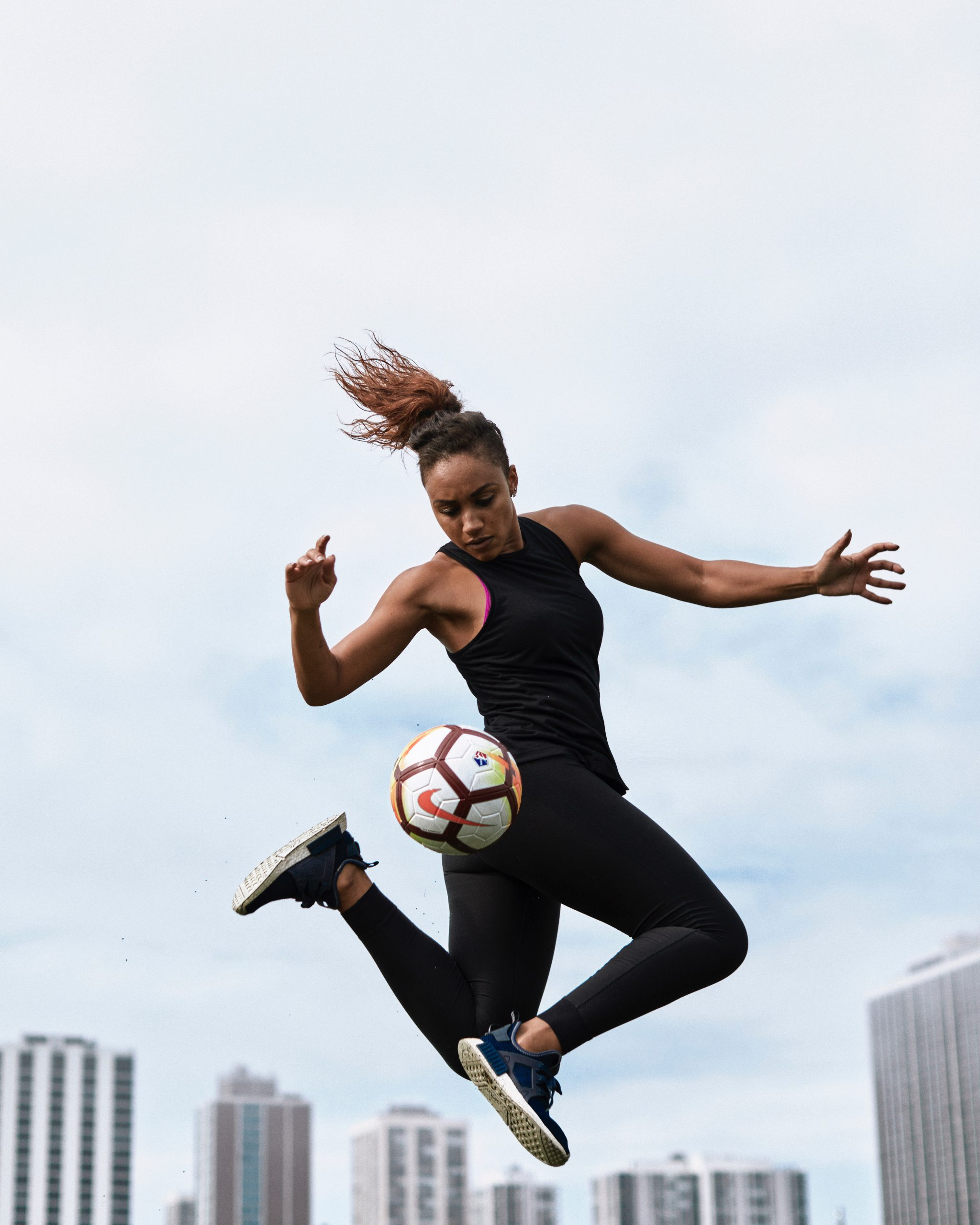 Samantha a professional soccer player performing ball tricks scaled