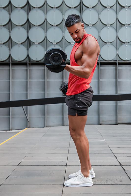 Mark melbournes mediteranian fitness model curling dumbbells