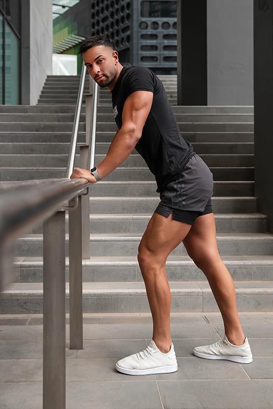 Mark melbournes mediteranian fitness model leaning against a railing