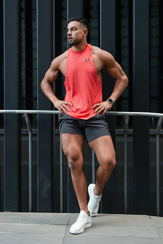 Mark melbournes mediteranian fitness model standing casually with his hands on his hips