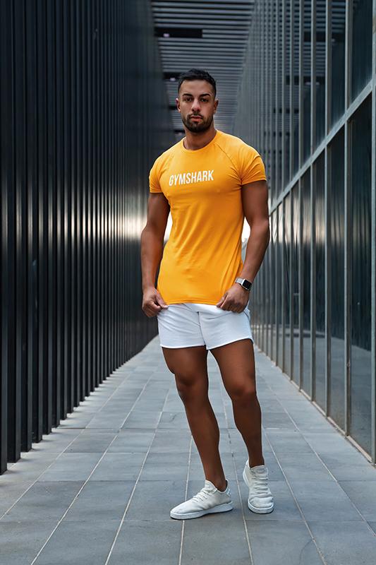 Mark melbournes mediteranian fitness model standing casually