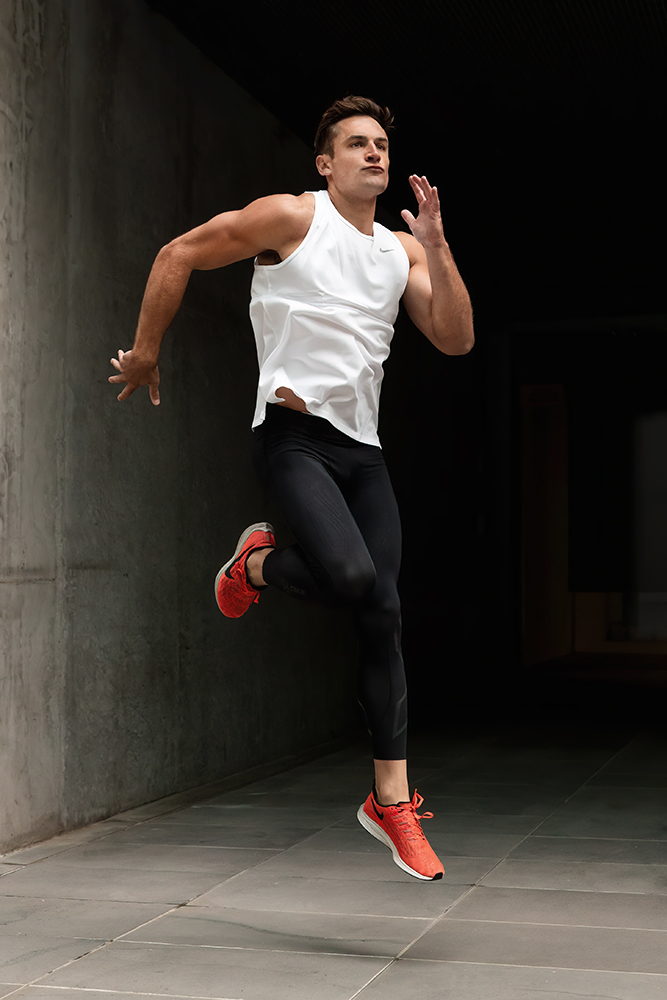 Mitchell ex Melbourne AFL star jumping through the air