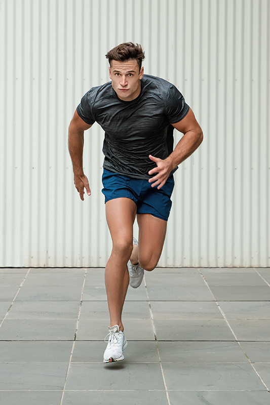 Mitchell ex Melbourne AFL star sprinting to the camera