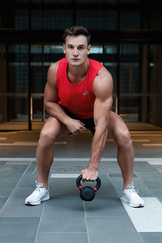 Mitchell ex Melbourne AFL star swinging a kettlebell