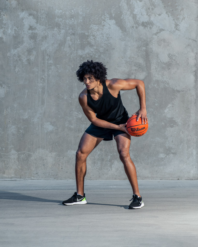 Sydney mixed race fitness model holding a basketball