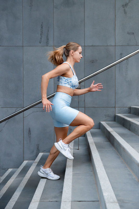 Alyson Melbourne dancer jogging up a flight of steps
