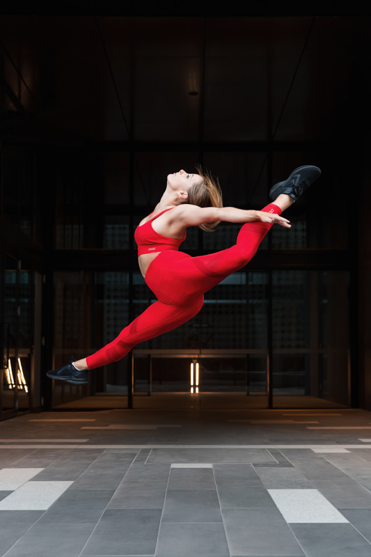 Alyson Melbourne dancer jumping and arching her back