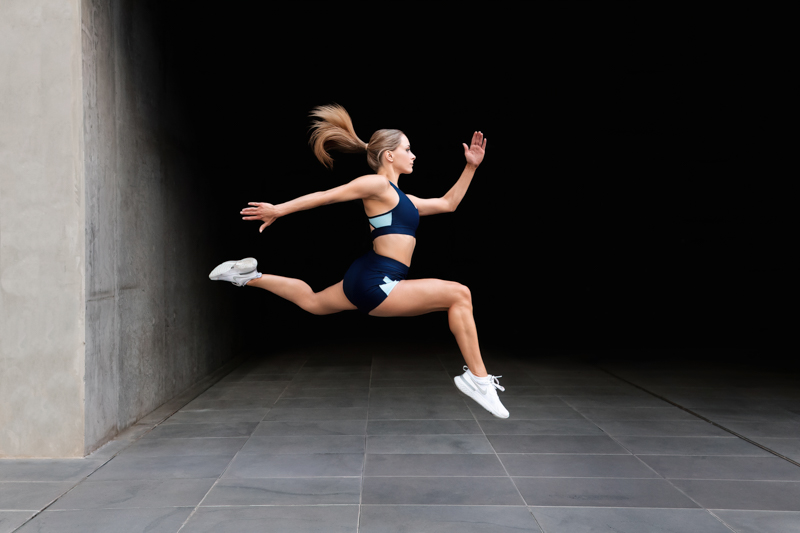 Alyson Melbourne dancer running through the streets of port melbourne