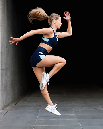 Alyson Melbournes talented fitness model and dancer jumping