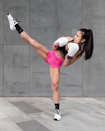 Katherine Melbourne South East Asian fitness model kicking