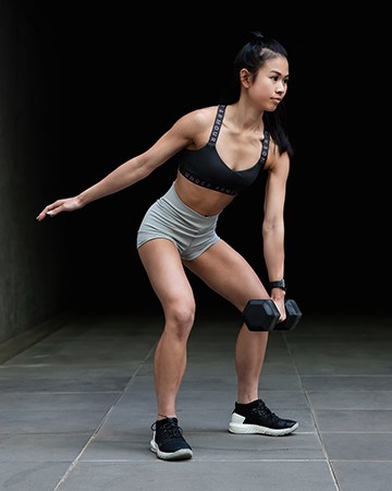 Katherine Melbourne South East Asian fitness model performing a one arm kettle bell swing