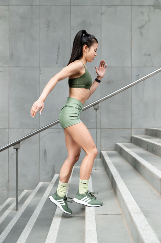 Katherine Melbourne based balinese fitness model running up a stair well