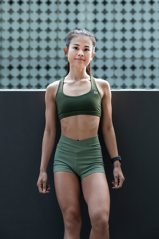 Katherine Melbourne based balinese fitness model wearing a green nike outfit