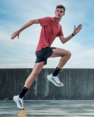 Flynn Sydney male model and elite 1500 meter runner sprinting out of the starter blocks