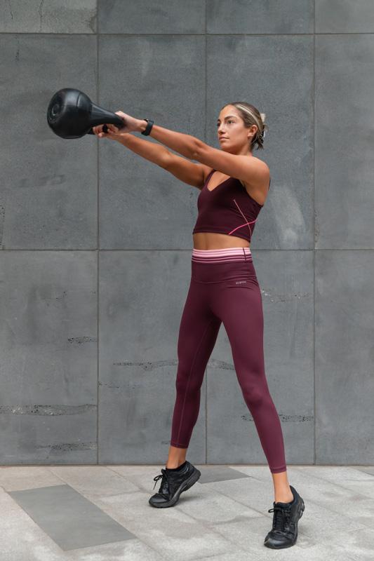 Isabella H Melbourne Australia Elite Fitness Model kettle bell swing throughs