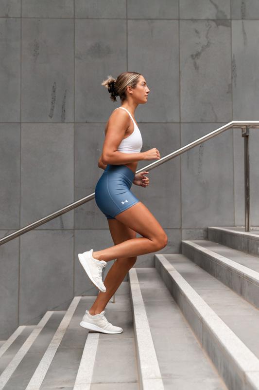 Isabella H Melbourne Australia Elite Fitness Model running up th steps
