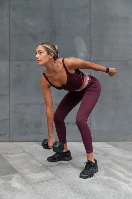 Isabella H Melbourne Australia Elite Fitness Model single arm dumbbell snatches