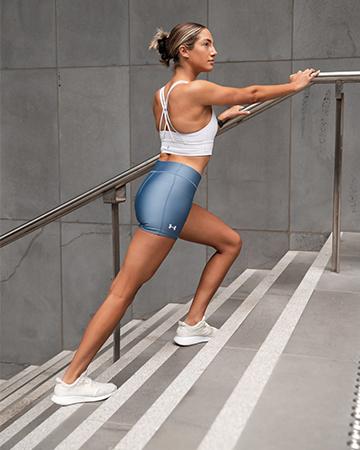 Isabella H Melbourne Australia Elite Fitness Model stretching on a bar