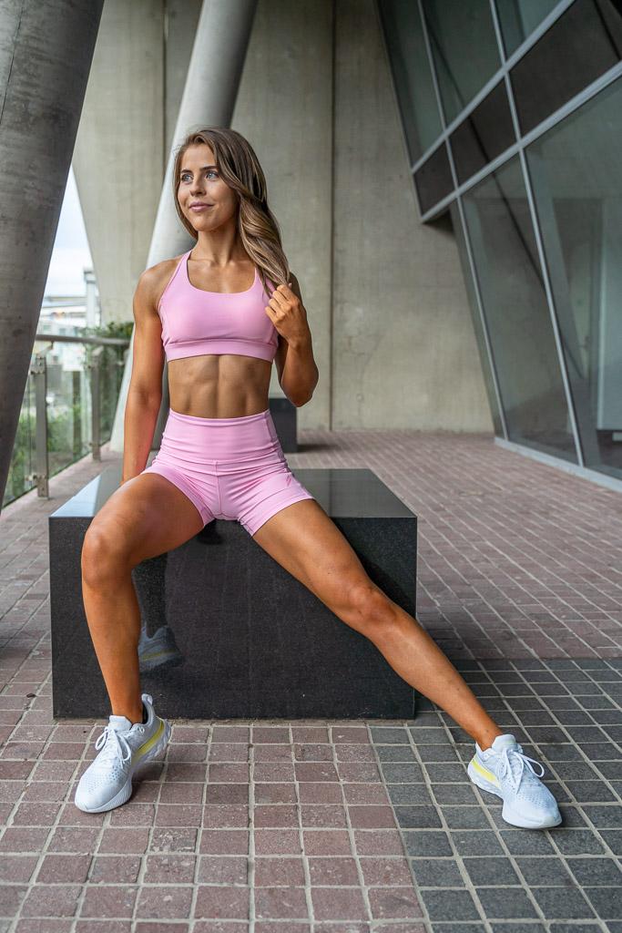 Natasha Australia Elite blonde fitness model side lunging