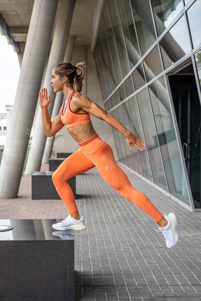 Natasha Australia Elite blonde fitness model stepping up on a concrete step