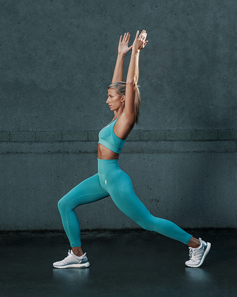 Samantha Sydney personal trainer fitness model doing a yoga pose stretch