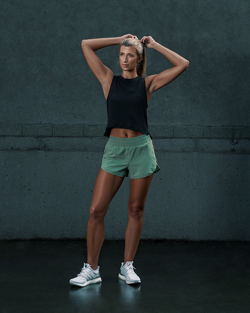 Samantha Sydney personal trainer fitness model stretching her arms abover head