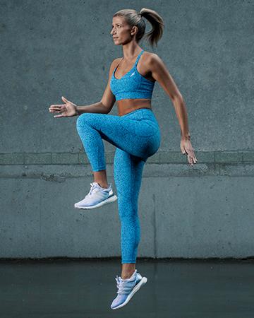 Samantha Sydney personal trainer fitness model wearing green running apparel