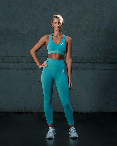 Samantha Sydney personal trainer fitness model wearing vibrant green fitness garments