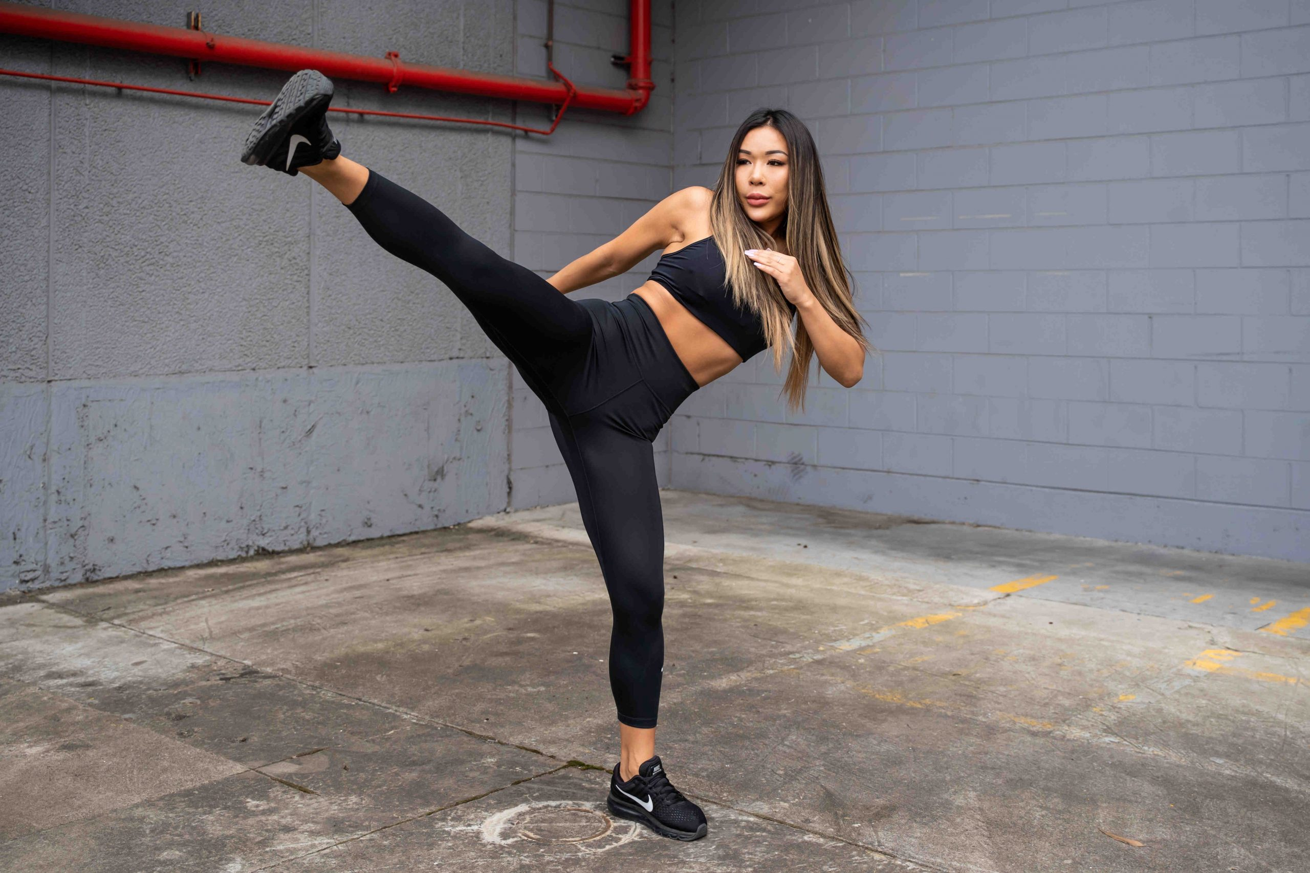 Zora Sydneys chinese fitness model doing a high kick scaled